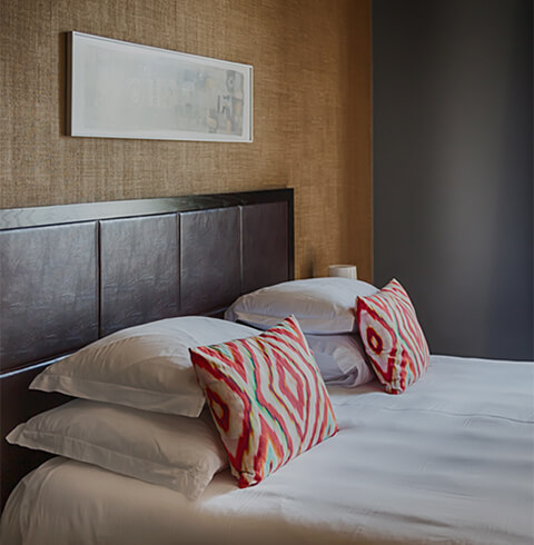 Bed with colored pillows