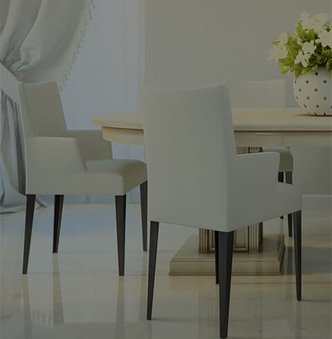Three white chairs and a table